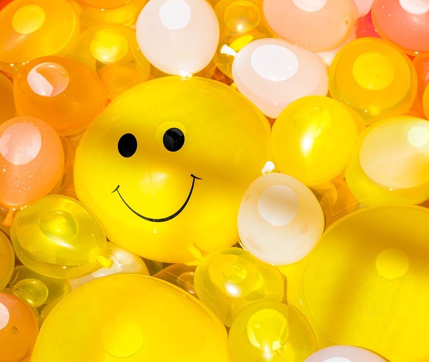 yellow helium balloon smiling face